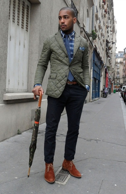 With checked shirt, blue tie, puffer jacket and dark colored pants