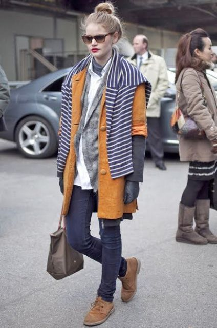With white shirt, gray cardigan, brown coat, jeans and small bag