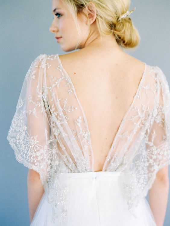an open back with airy embroidered and beaded details