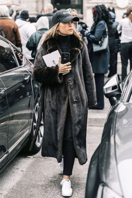 With pants, maxi fur coat and white sneakers