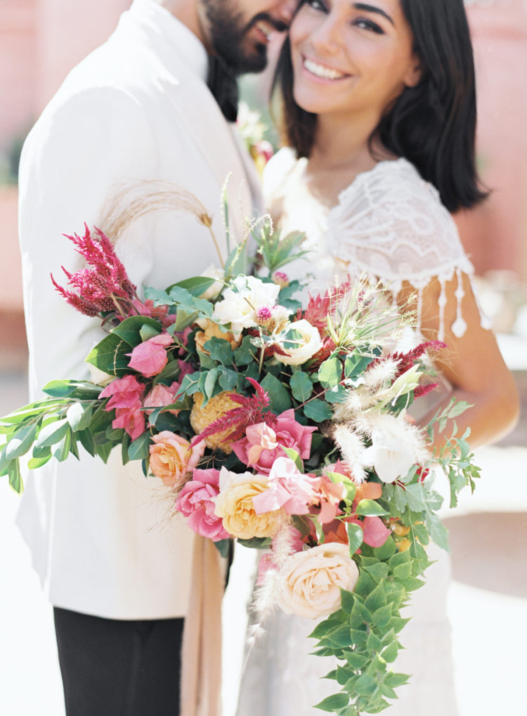 The bridal bouquet was a textural and lush one, with cascading greenery and bold blooms