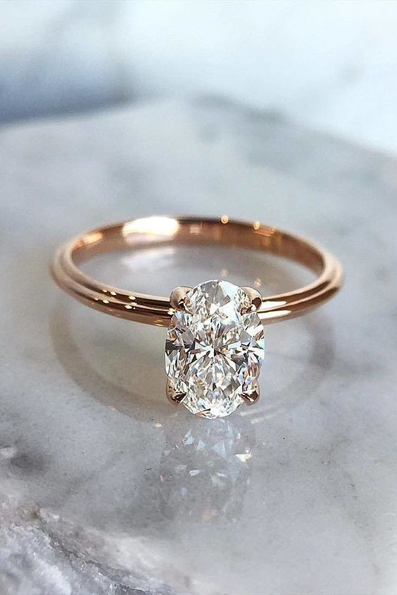a rose gold engagement ring with an oval diamond solitaire is another classic idea to try