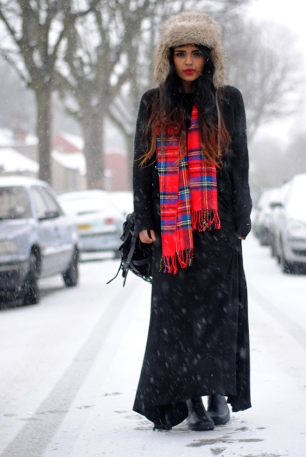 With maxi coat, maxi dress, flat boots, backpack and plaid scarf