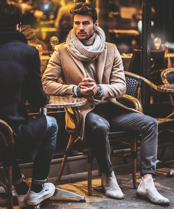 grey jeans, dove grey chelsea boots, a camel coat and a neutral scarf