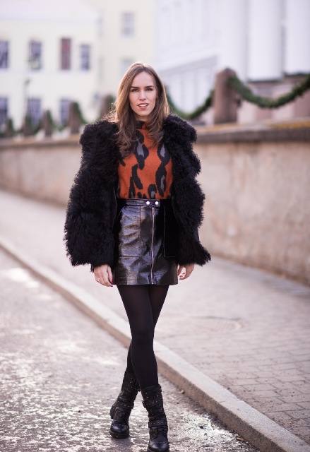With printed turtleneck, fur coat, black tights and mid calf boots