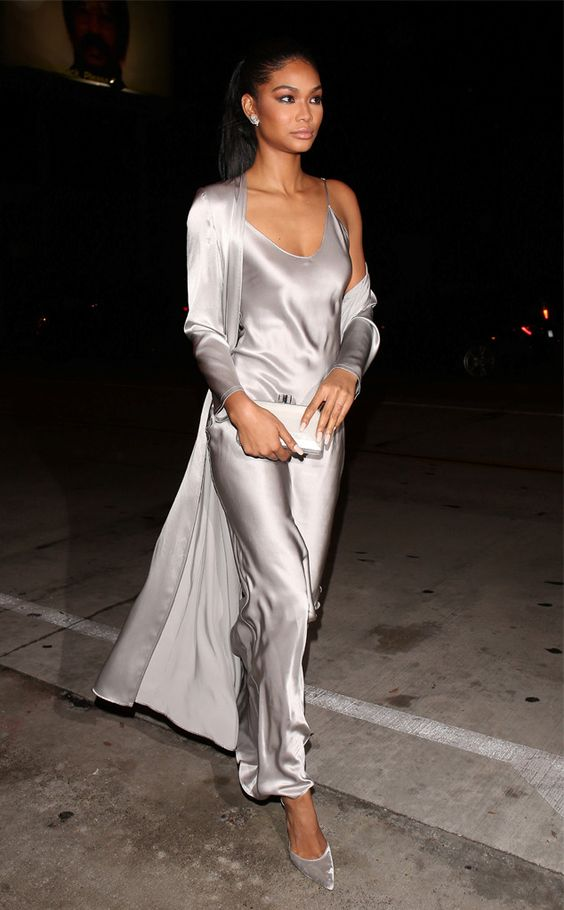 Chanel Iman wearing a silver slip maxi dress, a matching long cardigan and silver velvet shoes