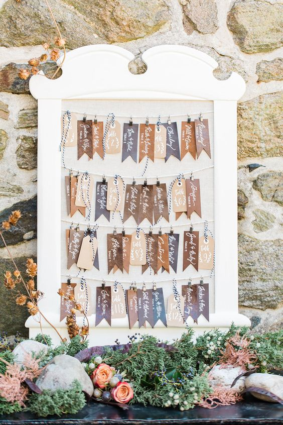 a leather tag seating chart is a cool idea for a rustic wedding