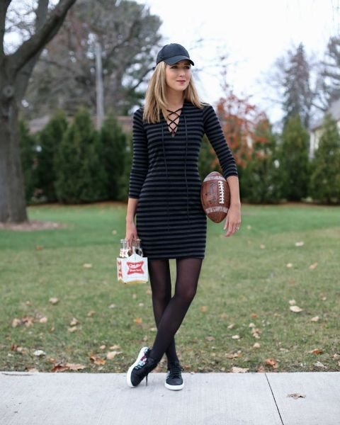 With striped dress and sneakers