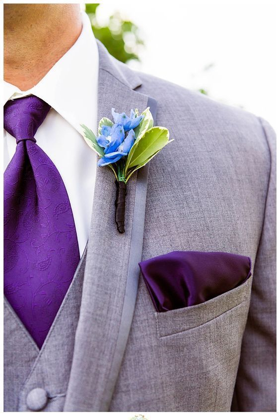 an ultra violet tie and a handkerchief to make the groom's look chic and trendy
