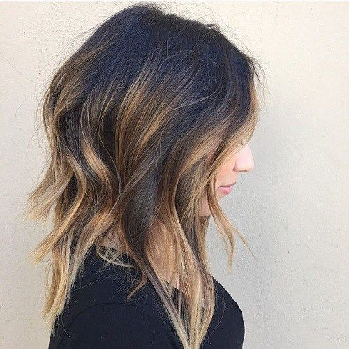 a messy wavy long bob with balayage is effortlessly chic
