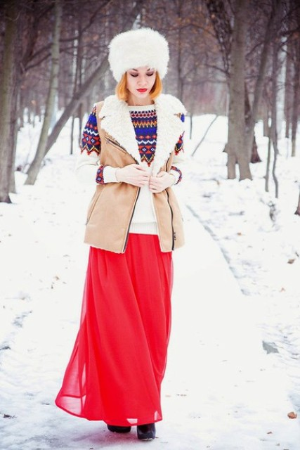 With red maxi skirt, printed sweater and fur hat