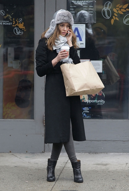 With black coat, dress, gray tights and leather boots