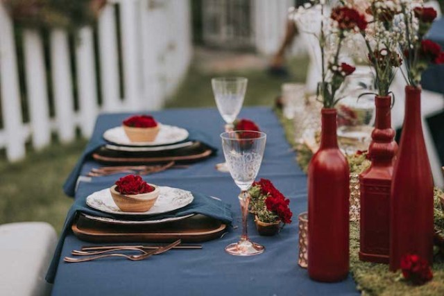 Red bottles as vases and lots of candles made the tablescapes even cooler