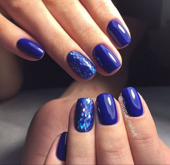 violet manicure with holographic nails that remind of fish scales