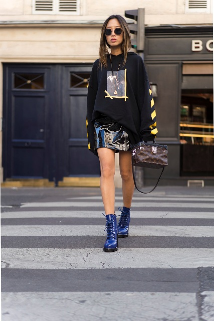With printed hoodie, blue boots and printed bag