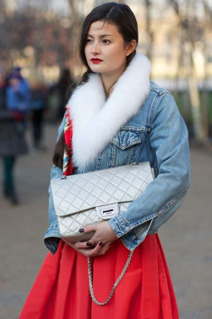 With red skirt and silver bag