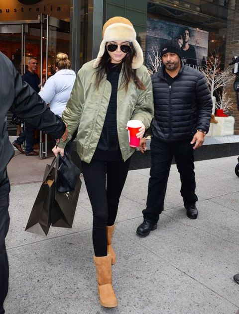 With black shirt, black leggings, Uggs and olive green jacket