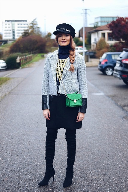 With gray coat, over the knee boots and green mini bag