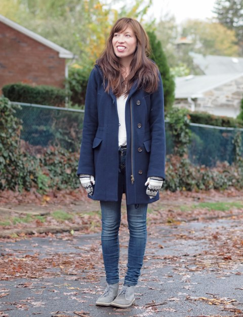 With white shirt, navy blue coat and skinny jeans