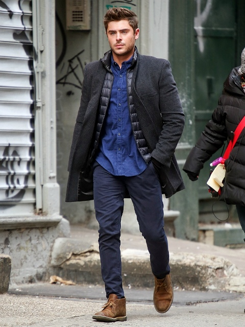 With blue shirt, puffer vest, coat and navy blue pants