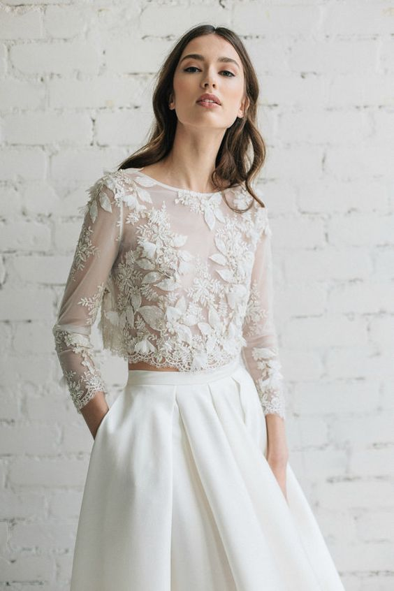 a sheer top with appliques and beading looks very romantic and edgy at the same time