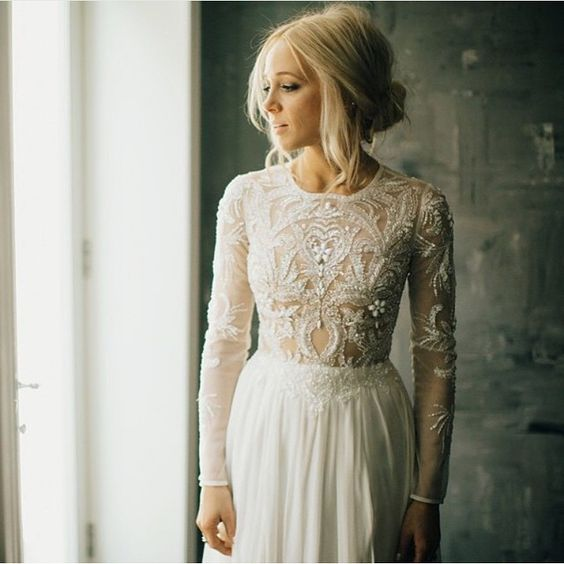 an illusion embroidered and embellished bodice and sleeves looks refined and sexy