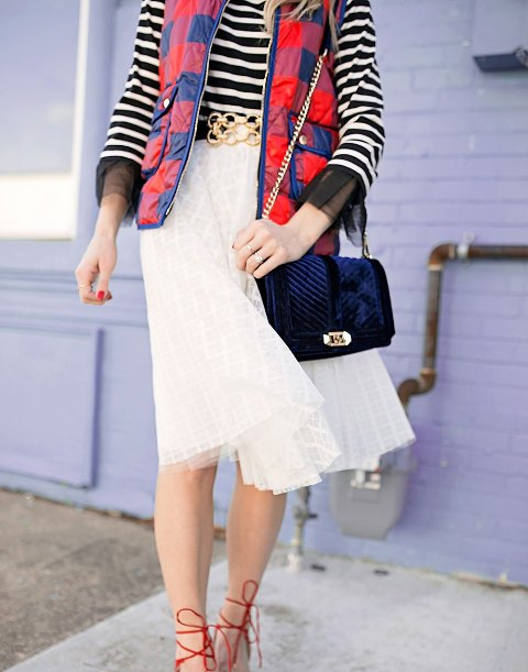 With striped shirt, white skirt and velvet bag