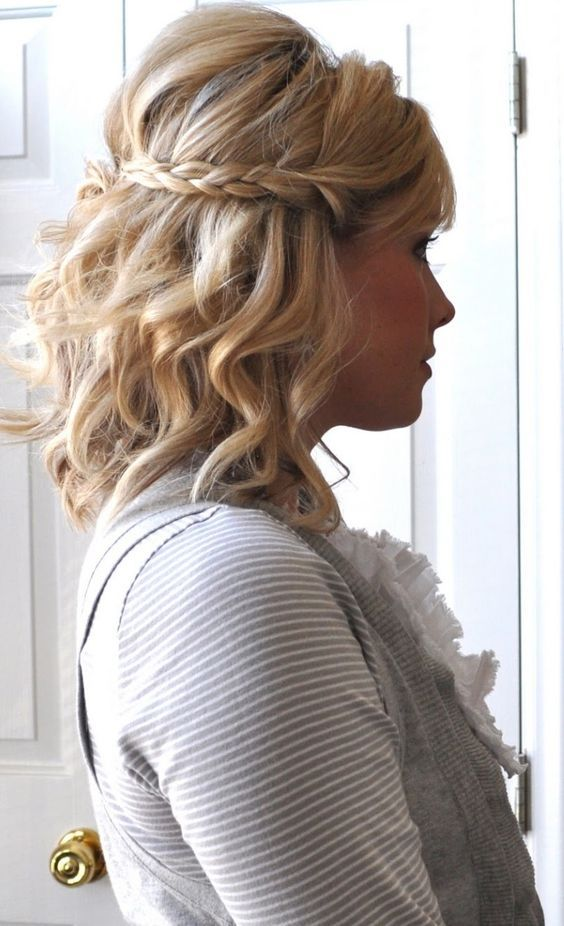 a wavy half updo with a braid and volume on top is suitable for medium length hair