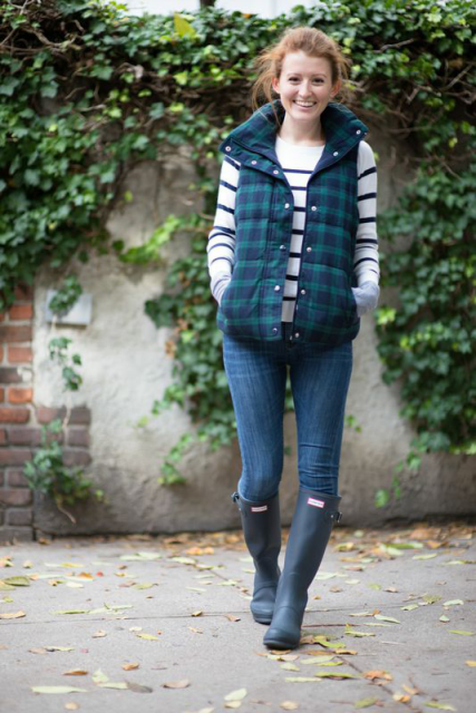 With striped shirt, jeans and gray high boots