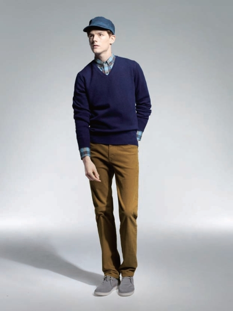 With checked shirt, navy blue sweater, blue cap and brown trousers