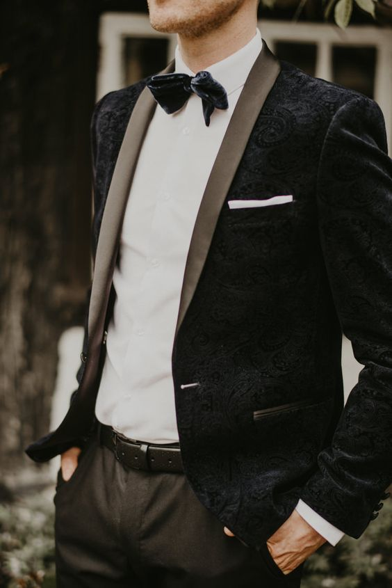 a chic vintage-inspired black velvet jacket and a black velvet bow tie for an exqusite look