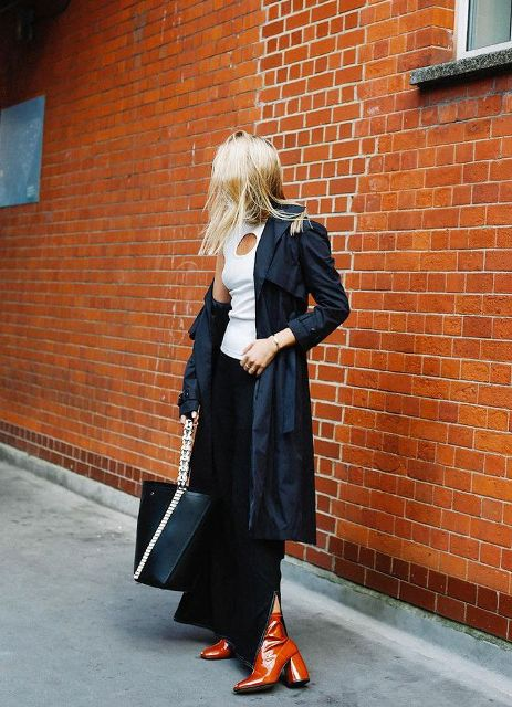 With white top, navy blue trench coat, maxi skirt and tote