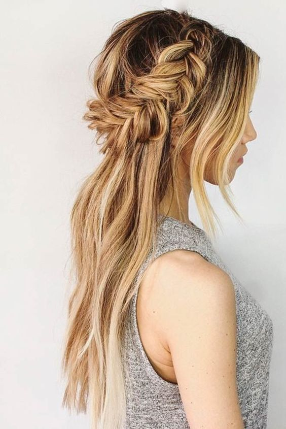 a half up fishtail braid hairstyle with bangs and hair down