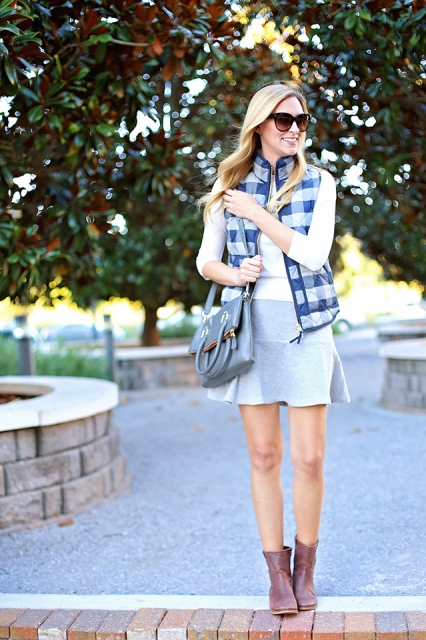 With white shirt, mini skirt, gray bag and brown boots