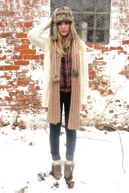 With plaid shirt, white cardigan, knitted scarf, cuffed jeans and boots