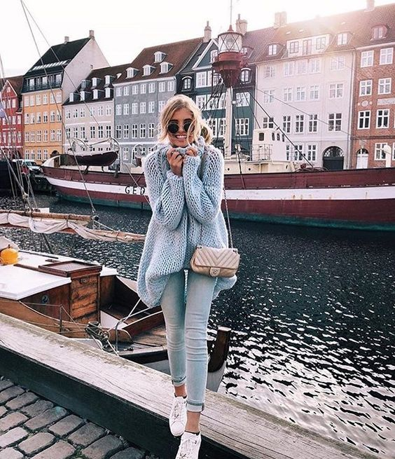 light denim, a grey chunky knit oversized sweater, white sneakers