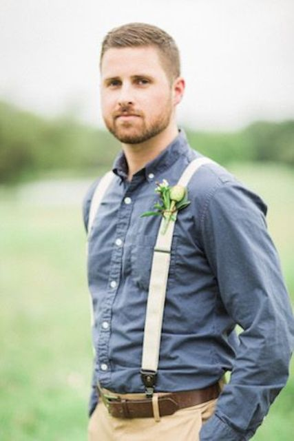 tan pants, a chambray shirt, crwamy suspenders and no tie for a country wedding