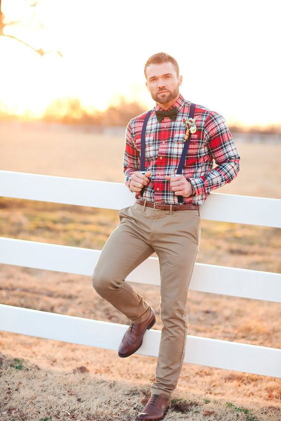 tan pants, a plaid shirt, navy suspenders with a black bow tie and cognac shoes for a rustic Christmas-inspired look