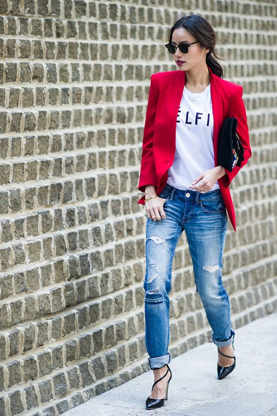 ripped jeans, a printed tee, a hot red blazer and black strappy shoes