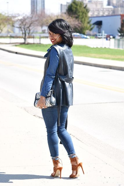 With denim shirt, jeans, brown heels and printed clutch