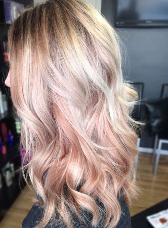 blonde hair with rose gold highlights looks very girlish