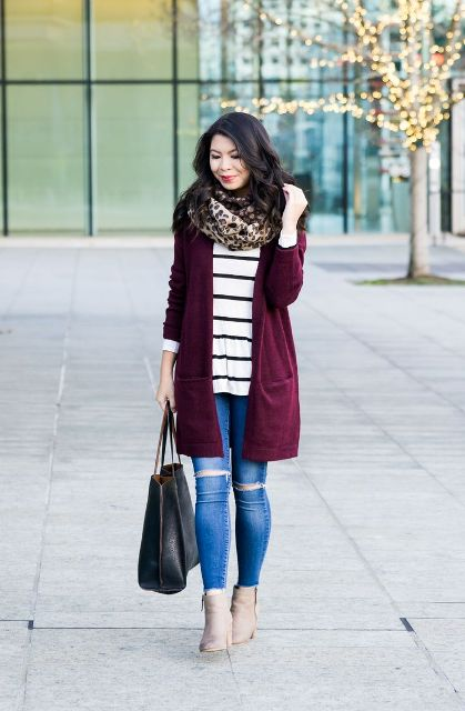 With striped long sweatshirt, marsala cardigan, distressed jeans, beige ankle boots and black tote
