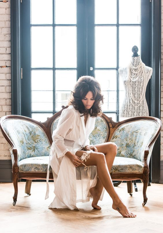 a long white bridal robe with a ruffle trim on the sleeves is a timeless option