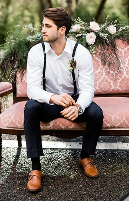 black pants, a white shirt, black narrow suspenders, amber shoes and a boutonniere