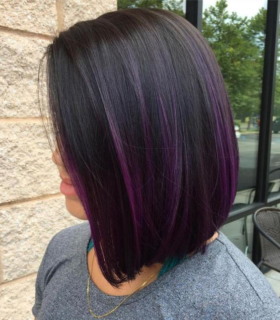 a sleek dark chestnut bob with a subtle purple balayage for a stylish accent