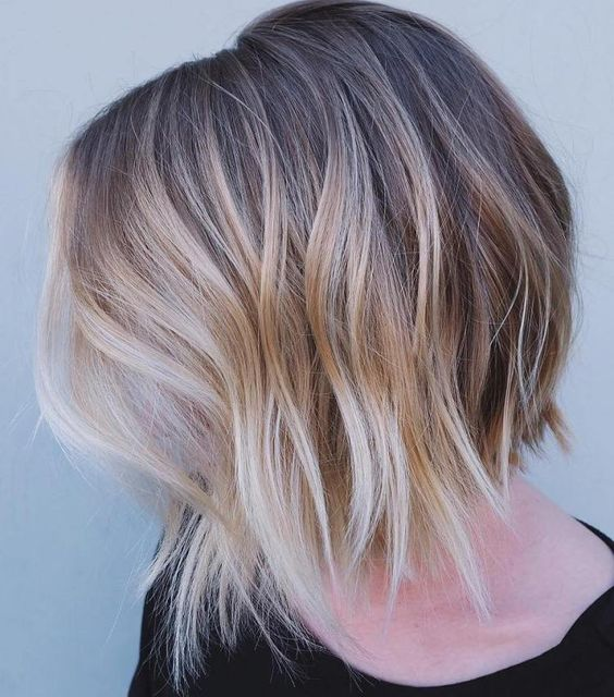 brown bob haircut with an uneven edge and blond balayage for a mind-blowing look