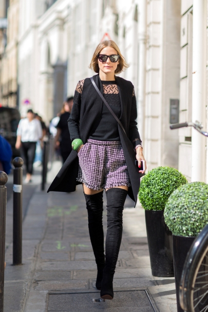 With black shirt, black long vest, crossbody bag and over the knee boots