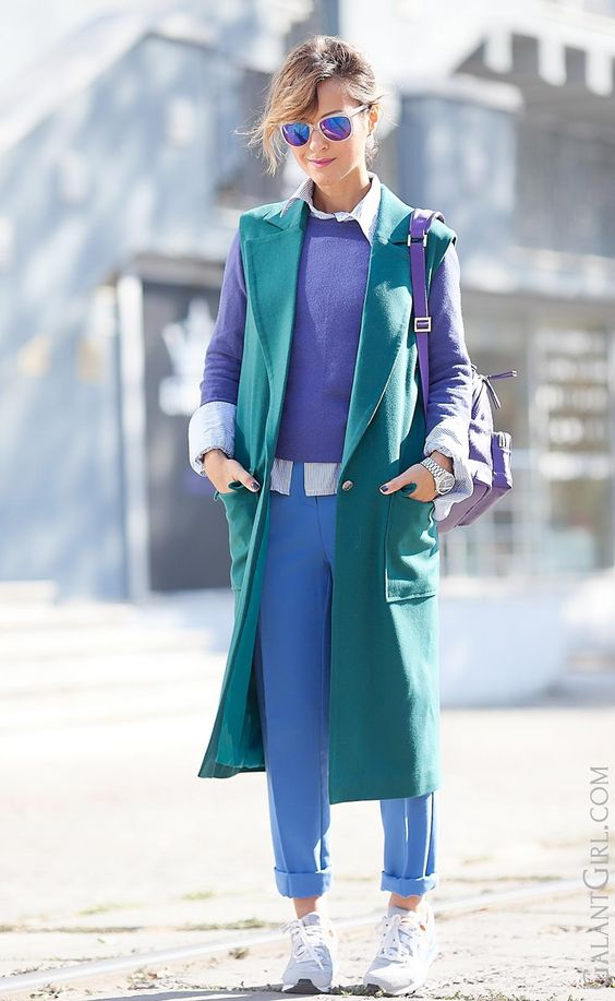 a color block look with blue pants, an ultraviolet jumper, a shirt and a sleeveless reen coat