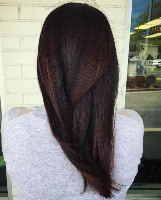 black hair with plum-colored and caramel balayage looks jaw-dropping