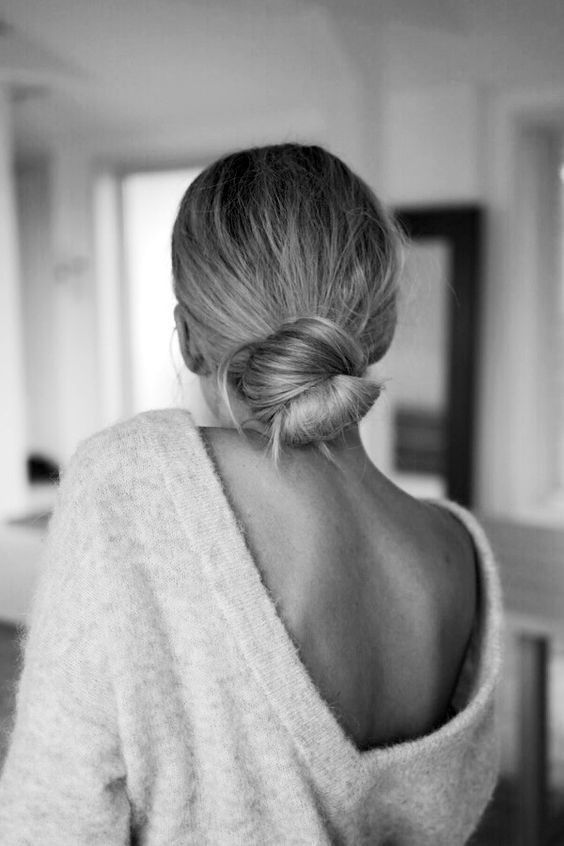 a simple and elegant low bun can be worn with a hat